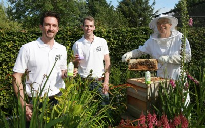 Ron Harper tending the bees with son, Joe and Andy Sugden