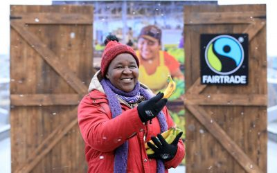 """Picture Caption: A giant double doorway was erected on a snow covered Millennium Bridge this morning to reveal a banana farm in rural Panama. The stunt marked the start of the Fairtrade Fortnight """"Come On In"""" campaign, calling on the public to stand with farmers to close the door on exploitation and break the stranglehold of poverty prices. Celebrity chef, food writer and author Tess Ward was on hand to show her support and give out Fairtrade bananas while passers-by were invited to step onto a Panama banana farm by virtue of a new immersive 360 virtual reality film. Farmer Ketra Kyosiimire from Uganda is also pictured handing out bananas.    FAIRTRADE INVITES BRITISH PUBLIC TO 'COME ON IN' Giant double doorway opens onto banana washing station in rural Panama to mark the start of Fairtrade Fortnight 2018 26th February 2018, London: On the day new research  reveals half of Brits are unaware of exploitation in the food chain, a giant double doorway opening onto a scene from a banana farm was unveiled on the Millennium Footbridge, London.  The stunt marked the start of the Fairtrade Fortnight """"Come On In"""" campaign, calling on the public to stand with farmers to close the door on exploitation and break the stranglehold of poverty prices. Celebrity chef, food writer and author Tess Ward was on hand to show her support and give out Fairtrade bananas while passers-by were invited to step onto a Panama banana farm by virtue of a new immersive 360 virtual reality film.  This year we collectively chomped through a staggering 820,000 tonnes of bananas, eating on average 100 bananas each. Yet it's a scandalous reality that millions of farmers and workers are still being ripped off, despite working hard to provide the products we love. They face unfairness in global trade that is rooted in centuries of exploitation.  The banana industry provides employment for tens of thousands of people in Latin America, the Caribbean, south-east Asia and West Africa.  The past 1"""